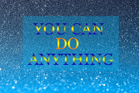 anything: you can do anything word on blue glitter abstract background