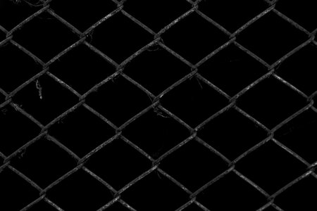 metal wire: Metal wire fence or cage with black background Stock Photo