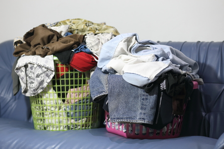 folded clothes: abstract The basket with not folded clothes, clothes are not wash