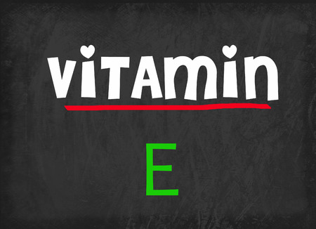 vitamin: Vitamin E on blackboard Stock Photo