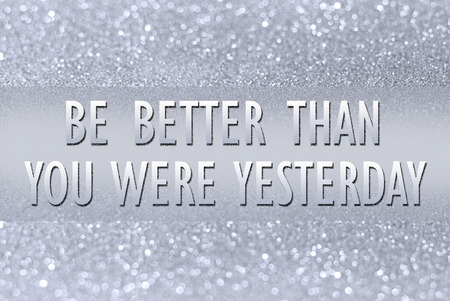 better: Be better than you were yesterday on glitter abstract background