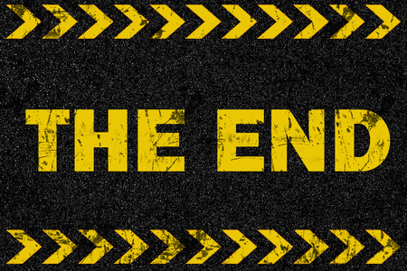 end: The end word on grunge background