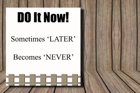later: Brown wooden wall background and Do it now sometimes later becomes never word