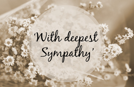 sympathy: With deepest sympathy note on small flower sepia tone Stock Photo