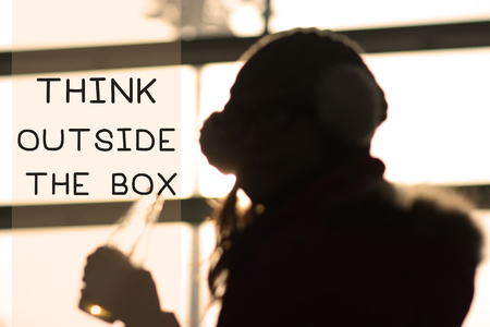 think through: woman looking through the window with think outside the box