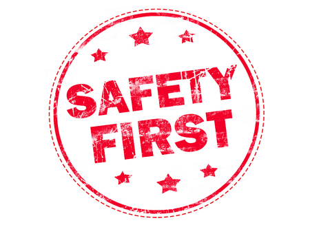 safety first: SAFETY FIRST on red grunge rubber stamp