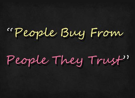 trust people: people buy from people they trust word on blackboard
