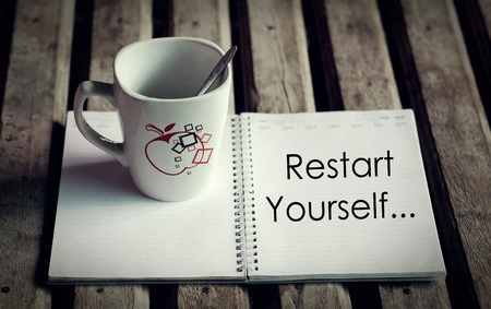 Restart Yourself word on diary with good morning concept