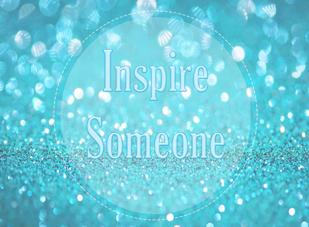 inspire: Inspire someone word on blue abstract bokeh background