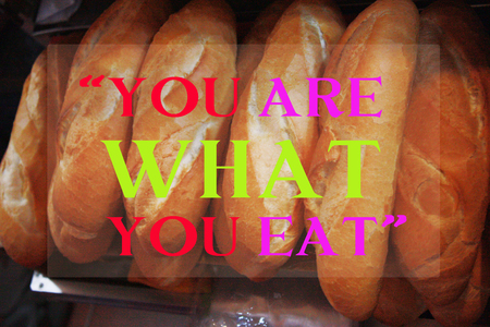 what to eat: you are what you eat quote on french bread background Stock Photo