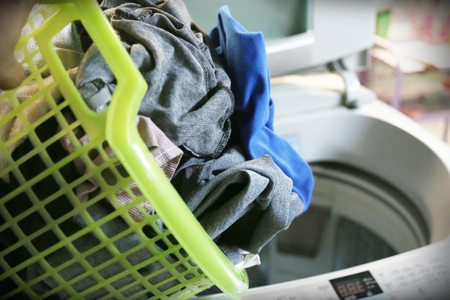 unwashed: clothes are not wash in a basket and washing machine
