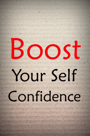 Self Confidence: Boost your self confidence word on cardboard background Stock Photo