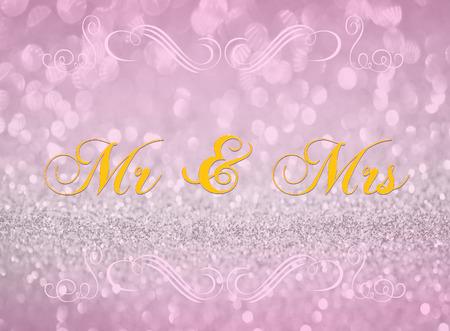 mrs: Sr. y se�ora en el fondo abstracto rosa de plata del brillo Foto de archivo