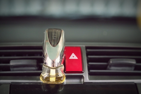 conditioned: emergency button in car and air conditioned perfume