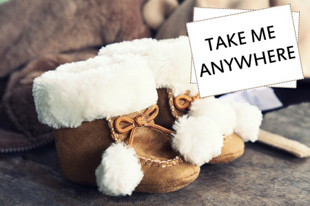 anywhere: baby shoes with word take me anywhere Stock Photo
