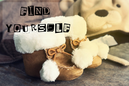 yourself: baby shoes with find yourself Stock Photo