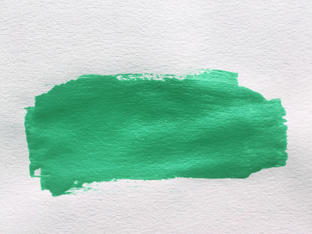 paint stroke: green paint smear stroke stain on white background
