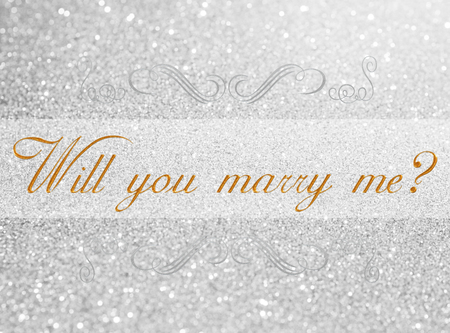 will you marry me: will you marry me? on white silver glitter bokeh abstract background