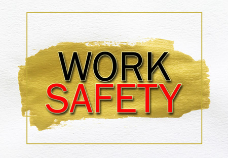 danger to life: work safety on gold paint smear stroke stain on white background
