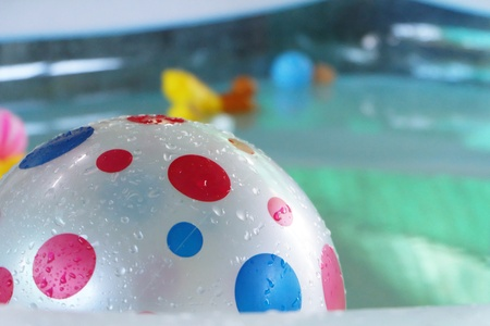 Balls in swimming pools Stock Photo