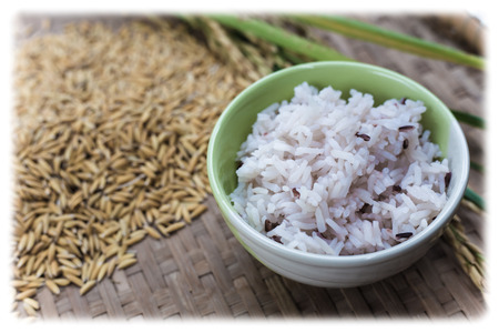 Rice on wooden background