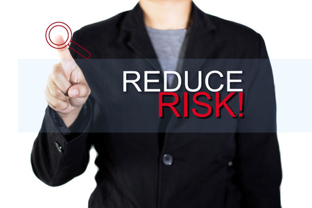 reduce risk: REDUCE RISK! touchscreen is operated by businessman. Stock Photo