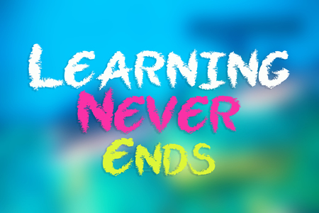 LEARN NEVER ENDS card on blurred blue background Stock Photo
