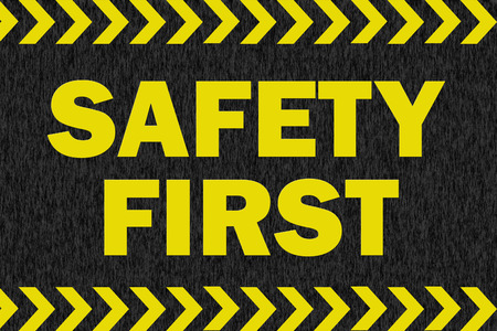 safety first: SAFETY FIRST sign on black background Stock Photo