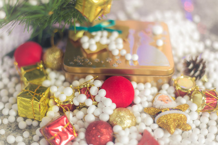 chirstmas: Gift boxes and ornaments in Merry Christmas and Happy New Year concept with bokeh background, can be use for make a greeting cards. Stock Photo