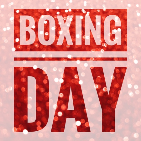 Boxing Day sale words on shiny red glitter background Stock Photo