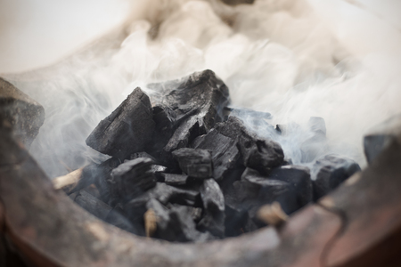 briquettes: Charcoal BBQ blazing and glowing