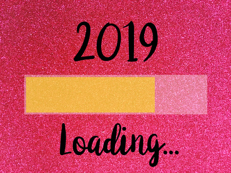 Goodbye 2018 Hello 2019, loading New Year words on Pink glitter texture Christmas abstract background.
