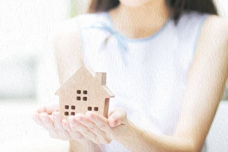 Oil painting effect: woman holding wooden home model on hand. 写真素材