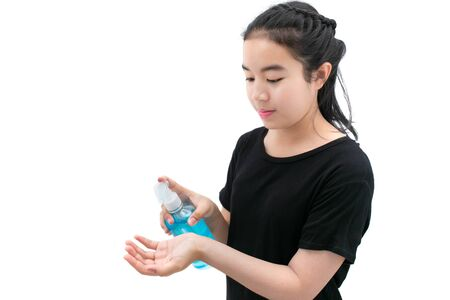 Girl in medical mask cleans hands with antiseptic or alcohol cleansing gel with Do not let virus spread concept.