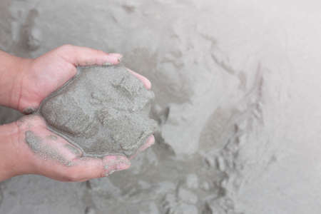 Sand on the beach and child's hand. 写真素材
