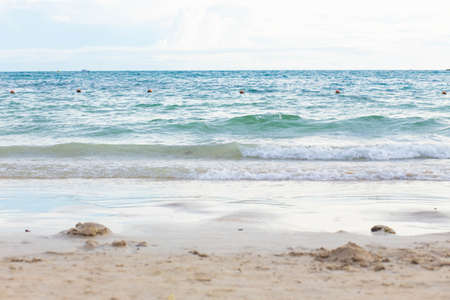 Ocean wave on tropical sandy beach in summer. Beautiful view.