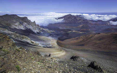 Looking down into the colorful but barren volcanic crater of Haleakala in Maui, Hawaii, USA.