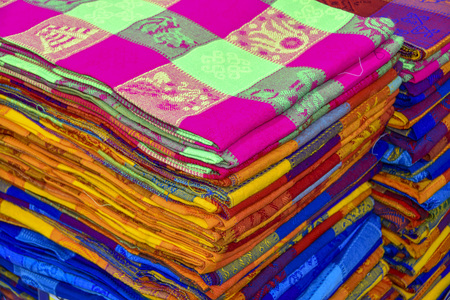 autochthonous: Many multicolored textiles being representative for the latin america culture and sold as souvenirs at chichen itza, yucatan mexico.
