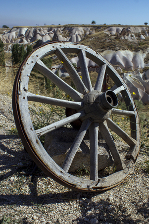 A old car wheel, left in a landscape, Turkey, Wooden wheel made according to an old tradition Stock Photo