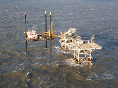 A liftboat provides access to an offshore oil platform