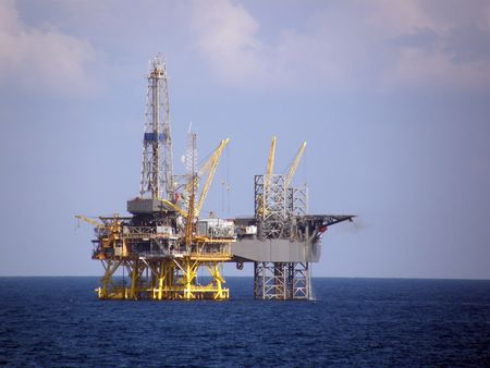 drilling rig: Fixed oil platform and mobile jack-up drilling rig Stock Photo