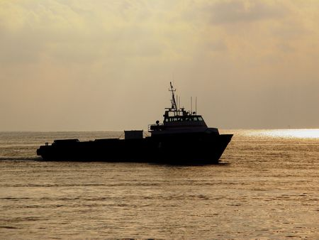 Crewboat in the Gulf of Mexico, silhouette