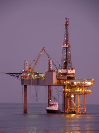 distant work: Offshore oil rig and platform at twilight