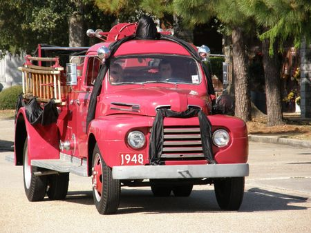 pumper: Antique fire engine draped with mourning bands
