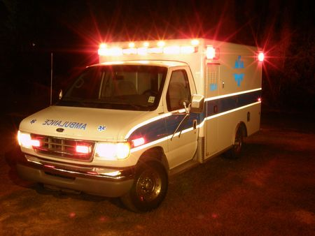 yelp: Ambulance at night with emergency lights on