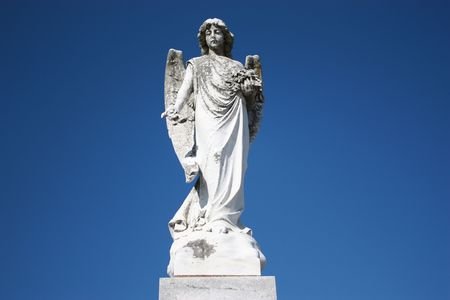 Weathered mourning angel in New Orleans cemetery Stock Photo - 4486529