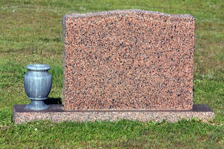plots: Blank granite tombstone with marble vase