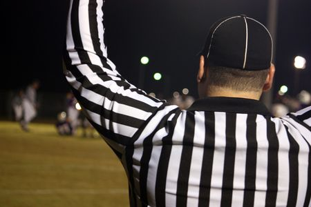 Football referee signals a touchdown