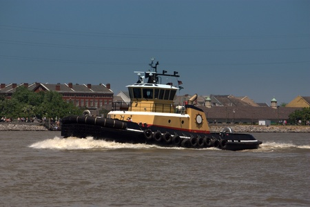 A Z-drive tug navigates the Mississippi River at New Orleans