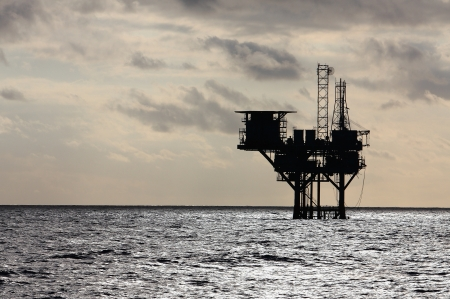 crude oil: Silhouette of an oil production platform in the Gulf of Mexico
